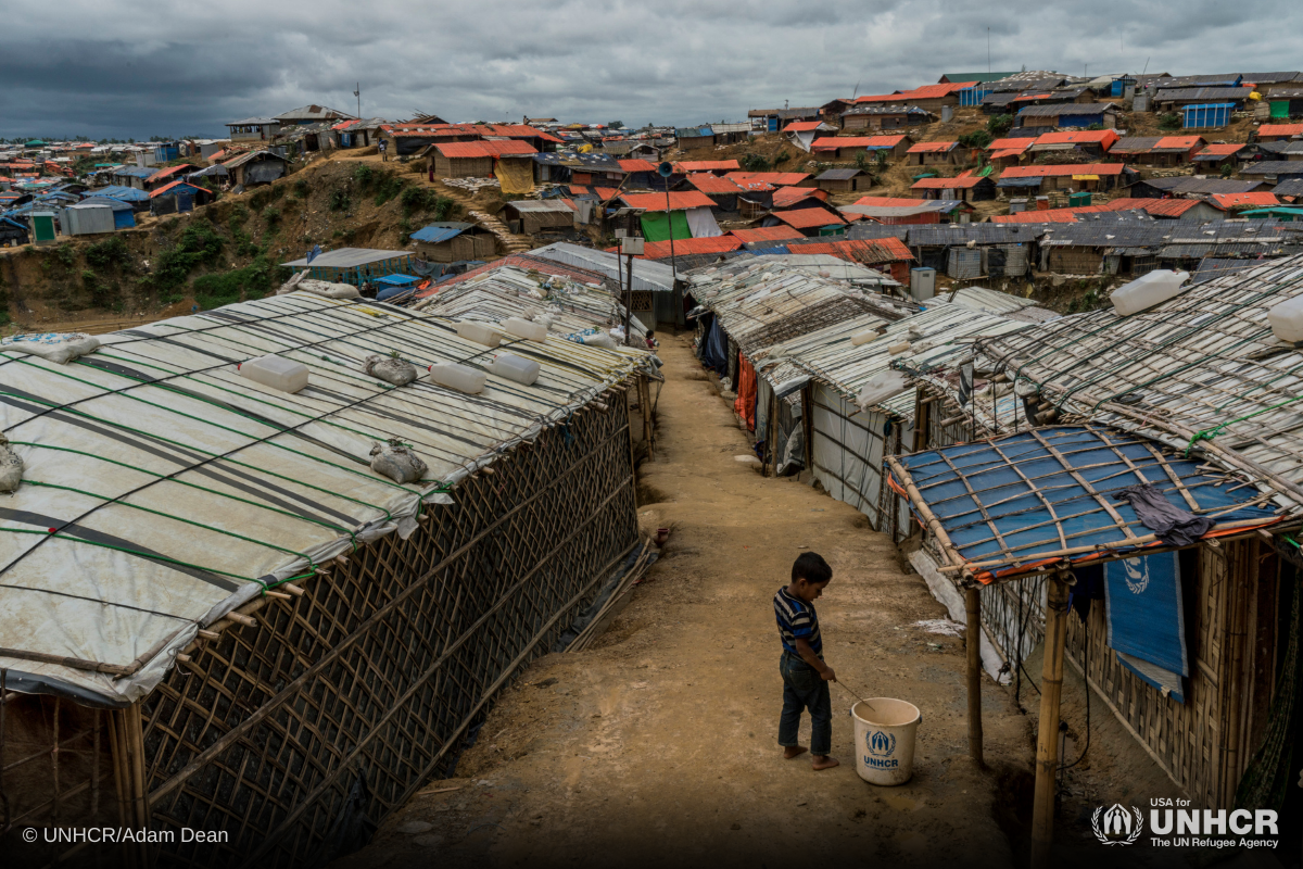 A boy stands between shelters on raised ground at Kutupalong refugee camp, where an operation to relocate thousands of families at risk from the monsoon downpours is underway.